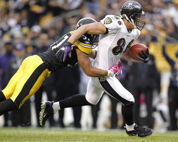 PITTSBURGH - OCTOBER 03: Todd Heap #86 of the Baltimore Ravens treis to escape the tackle of James Farrior #51 of the Pittsburgh Steelers on October 3, 2010 at Heinz Field in Pittsburgh, Pennsylvania. Baltimore won the game 17-14. (Photo by Gregory Shamus