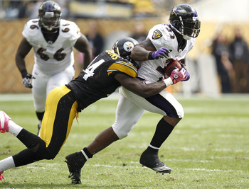 PITTSBURGH - OCTOBER 03:  Willis McGahee #23 of the Baltimore Ravens tries to escape the tackle of Lawrence Timmons #94 of the Pittsburgh Steelers on October 3, 2010 at Heinz Field in Pittsburgh, Pennsylvania. Baltimore won the game 17-14.  (Photo by Greg