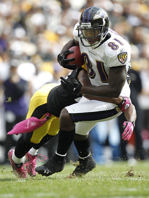 PITTSBURGH - OCTOBER 03:  Anquan Boldin #81 of the Baltimore Ravens looks for yards after the catch next to Ryan Clark #25 of the Pittsburgh Steelers on October 3, 2010 at Heinz Field in Pittsburgh, Pennsylvania.  (Photo by Gregory Shamus/Getty Images)
