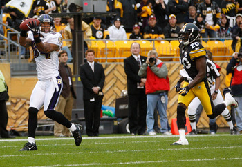 PITTSBURGH - OCTOBER 03:  TJ Houshmandzadeh #84 of the Baltimore Ravens catches the game winning touchdown in front of Bryant McFadden #20 of the Pittsburgh Steelers during the game on October 3, 2010 at Heinz Field in Pittsburgh, Pennsylvania.  (Photo by
