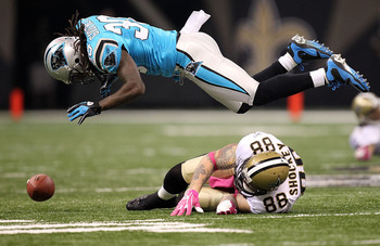 NEW ORLEANS - OCTOBER 03:  Tight end Jeremy Shockey #88 of the New Orleans Saints drops a pass against Charles Godfrey #30 of the Carolina Panthers at the Louisiana Superdome on October 3, 2010 in New Orleans, Louisiana.  (Photo by Ronald Martinez/Getty I
