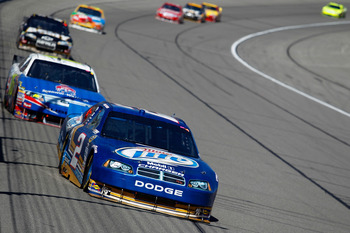 KANSAS CITY, KS - OCTOBER 03:  Kurt Busch, driver of the #2 Miller Lite Dodge, leads a pack of cars during the NASCAR Sprint Cup Series Price Chopper 400 on October 3, 2010 in Kansas City, Kansas.  (Photo by Todd Warshaw/Getty Images)