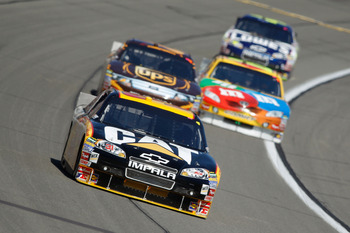 KANSAS CITY, KS - OCTOBER 03:  Jeff Burton, driver of the #31 Caterpilliar Chevrolet, leads a line of cars during the NASCAR Sprint Cup Series Price Chopper 400 on October 3, 2010 in Kansas City, Kansas.  (Photo by Todd Warshaw/Getty Images)