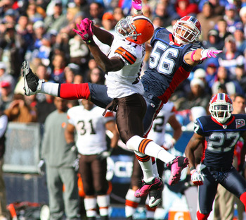 ORCHARD PARK, NY - OCTOBER 11: Mohammed Massaquoi #11 of the Cleveland Browns and Keith Ellison #56 of the Buffalo Bills try to make a play at Ralph Wilson Stadium on October 11, 2009 in Orchard Park, New York.  (Photo by Rick Stewart/Getty Images)