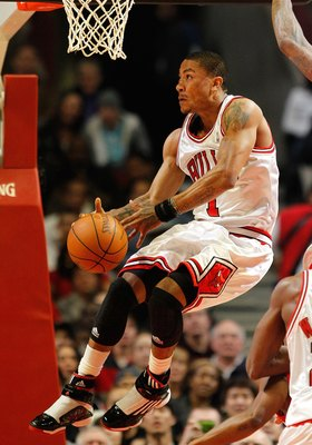 CHICAGO - MARCH 22: Derrick Rose #1 of the Chicago Bulls tries to control the ball against the Houston Rockets at the United Center on March 22, 2010 in Chicago, Illinois. The Bulls defeated the Rockets 98-88. NOTE TO USER: User expressly acknowledges and