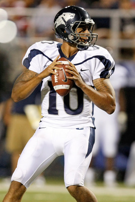 LAS VEGAS - OCTOBER 02:  Quarterback Colin Kaepernick #10 of the Nevada Reno Wolf Pack looks to pass against the  UNLV Rebels in the third quarter of their game at Sam Boyd Stadium October 2, 2010 in Las Vegas, Nevada. Nevada Reno won 44-26.  (Photo by Et