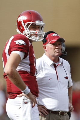 FAYETTEVILLE - SEPTEMBER 25: Head coach Bobby Petrino and quarterback Ryan Mallett #15 of the Arkansas Razorbacks look on during the first half against the Alabama Crimson Tide at Donald W. Reynolds Razorback Stadium on September 25, 2010 in Fayetteville,