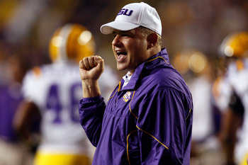 BATON ROUGE, LA - SEPTEMBER 25:  Head coach Les Miles of the Louisiana State University Tigers cheers during pregame before playing the West Virginia Mountaineers at Tiger Stadium on September 25, 2010 in Baton Rouge, Louisiana.  The Tigers defeated the M