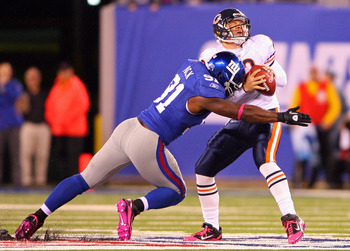EAST RUTHERFORD, NJ - OCTOBER 03:  Justin Tuck #91 of the New York Giants sacks against Caleb Hanie #12 of the Chicago Bear at New Meadowlands Stadium on October 3, 2010 in East Rutherford, New Jersey.  (Photo by Andrew Burton/Getty Images)