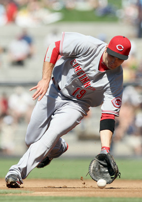 SAN DIEGO, CA - SEPTEMBER 26:  First Baseman Joey Votto #19 of Cincinnati Reds makes a play on a ground ball for an out against the San Diego Padres during their MLB game on September 26, 2010 at PETCO Park in San Diego, California. (Photo by Donald Miral