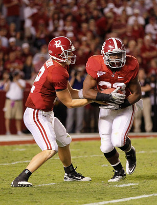 TUSCALOOSA, AL - OCTOBER 02:  Quarterback Greg McElroy #12 of the Alabama Crimson Tide hands the ball off to Mark Ingram #22 during the game against the Florida Gators at Bryant-Denny Stadium on October 2, 2010 in Tuscaloosa, Alabama.  (Photo by Kevin C.