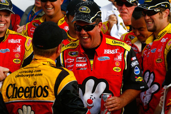 LOUDON, NH - SEPTEMBER 19:  Shane Wilson (C), crew chief of the #33 Cheerios/Hamburger Helper Chevrolet celebrates with driver Clint Bowyer (L) after Bowyer won the NASCAR Sprint Cup Series Sylvania 300 at New Hampshire Motor Speedway on September 19, 201