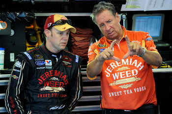 DAYTONA BEACH, FL - JULY 01:  Matt Kenseth (L), driver of the #17 Jeremiah Weed Ford, talks with crew chief Jimmy Fennig in the garage during practice for the NASCAR Sprint Cup Series Coke Zero 400 at Daytona International Speedway on July 1, 2010 in Dayt
