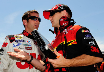 BROOKLYN, MI - JUNE 12:  Greg Biffle (L), driver of the #16 3M Ford, talks with crew chief Greg Erwin (R) during practice for the NASCAR Sprint Cup Series LifeLock 400 at Michigan International Speedway on June 12, 2009 in Brooklyn, Michigan.  (Photo by R