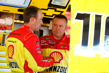 KANSAS CITY, KS - OCTOBER 01:  Kevin Harvick (L), driver of the #29 Shell/Pennzoil Chevrolet speaks with crew chief Gil Martin (R), during practice for the NASCAR Sprint Cup Series Price Chopper 400 on October 1, 2010 in Kansas City, Kansas.  (Photo by Ja