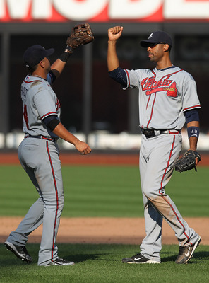 NEW YORK - SEPTEMBER 19: Derek Lee #27 of the Atlanta Braves celebrates the win with teammate Martin Prado #14 against the New York Mets at Citi Field on September 19, 2010 in the Flushing neighborhood of the Queens borough of New York City.  (Photo by Ni