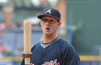 ATLANTA - APRIL 11: Outfielder Jordan Schafer #24 of the Atlanta Braves takes batting practice before play against the Washington Nationals on April 11, 2009 at Turner Field in Atlanta, Georgia.  (Photo by Al Messerschmidt/Getty Images)