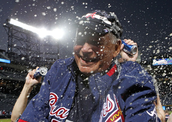 ATLANTA - OCTOBER 03:  Manager Bobby Cox #6 of the Atlanta Braves is doused by beer during the on-field playoff celebration after the game against the Philadelphia Phillies at Turner Field on October 3, 2010 in Atlanta, Georgia. The Braves beat the Philli