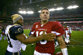 GLENDALE, AZ - DECEMBER 7:  Quarterback Kurt Warner #13 of the Arizona Cardinals is congratulated by Torry Holt  #81 after the Cardinal's 34-10 win over the St. Louis Rams to clinch the NFC West Title during their NFL Game on December 7, 2008 at the Unive