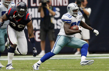 HOUSTON - SEPTEMBER 26:  Running back Felix Jones #28 of the Dallas Cowboys rushes past defensive end Mario Williams #90 of Houston Texans at Reliant Stadium on September 26, 2010 in Houston, Texas.  (Photo by Bob Levey/Getty Images)