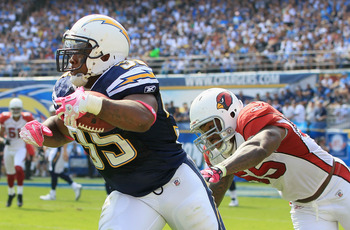 SAN DIEGO - OCTOBER 03:  Running back Mike Tolbert #35 of the San Diego Chargers carries the ball while being pursued by Joey Porter #55 of the Arizona Cardinals in the third quarter at Qualcomm Stadium on October 3, 2010 in San Diego, California. The Cha
