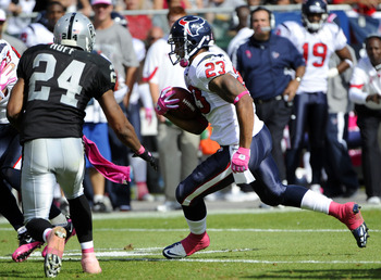 OAKLAND, CA - OCTOBER 3:  Running back Arian Foster #23 of the Houston Texans carries the ball against the Oakland Raiders  during an NFL football game October 3, 2010 at The Oakland-Alameda County Coliseum in Oakland, California. The Texans won the game