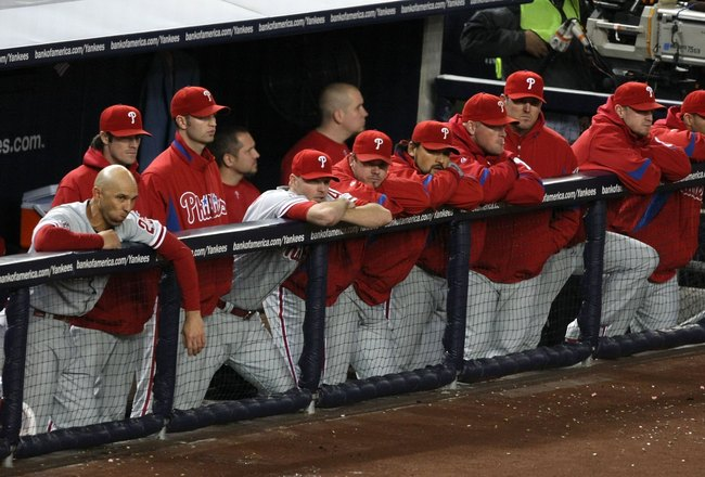 NEW YORK - NOVEMBER 04:   The Philadelphia Phillies stand dejected in the dugout late in the game against the New York Yankees in Game Six of the 2009 MLB World Series at Yankee Stadium on November 4, 2009 in the Bronx borough of New York City.  (Photo by