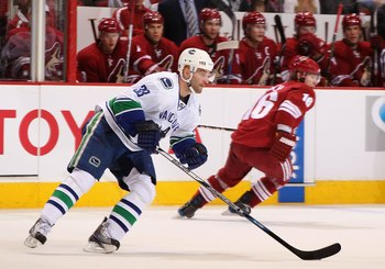 GLENDALE, AZ - MARCH 10:  Pavol Demitra #38 of the Vancouver Canucks skates with the puck during the NHL game against the Phoenix Coyotes at Jobing.com Arena on March 10, 2010 in Glendale, Arizona.  The Coyotes defeated the Canucks 4-3 in an overtime shoo