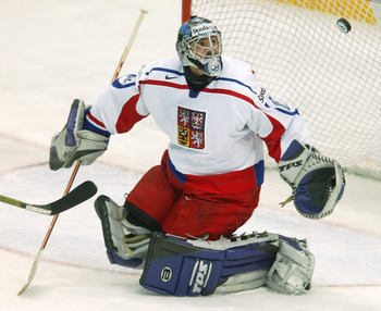 PRAGUE, CZECH REPUBLIC - MAY 2:  Goalie Roman Cechmanek of the Czech Republic deflects a Switzerland shot on goal in the teams' Group E qualifier match at the International Ice Hockey Federation World Championship May 2, 2004 in Prague, Czech Republic.  T