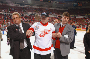 DETROIT, MI - JUNE 13:  Former Red Wing Vladimir Konstantinov is helped across the ice as Detroit celebrates winning the Stanley Cup after defeating the Carolina Hurricanes during game five of the NHL Stanley Cup Finals on June 13, 2002 at the Joe Louis A