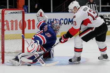 NEW YORK - OCTOBER 01: Goalkeeper Henrik Lundqvist #30 of the New York Rangers makes the winning save on a shot from Peter Regin #13 of the Ottawa Senators during their preseason game on October 1, 2010 at Madison Square Garden in New York City.  (Photo b