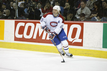 MONTREAL - APRIL 25:  Center Doug Gilmour #93 of the Montreal Canadiens skates with the puck during game four of the Stanley Cup playoffs against the Boston Bruins at the Molson Center in Montreal, Canada on April 25, 2002. The Bruins won 5-2.  (Photo by