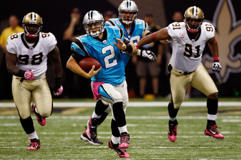 NEW ORLEANS - OCTOBER 03:  Jimmy Clausen #2 of the Carolina Panthers runs with the ball against the New Orleans Saints at the Louisiana Superdome on October 3, 2010 in New Orleans, Louisiana.   The Saints defeated the Panthers 16-14.  (Photo by Chris Gray
