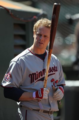 OAKLAND, CA - JUNE 06:  Justin Morneau #33 of the Minnesota Twins prepares to bat against the Oakland Athletics during an MLB game at the Oakland-Alameda County Coliseum on June 6, 2010 in Oakland, California.  (Photo by Jed Jacobsohn/Getty Images)