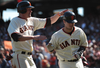 SAN FRANCISCO - SEPTEMBER 30:  Buster Posey #28 of the San Francisco Giants celebrates with Aubrey Huff #17 after hitting a two run home run in sixth inning against the Arizona Diamondbacks during a Major League Baseball game at AT&T Park on September 30,