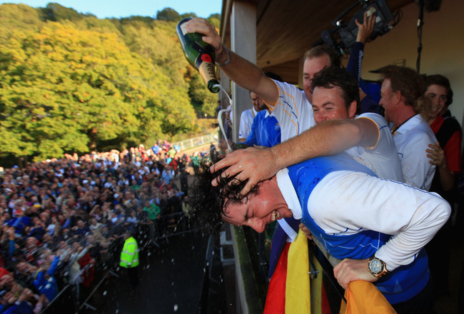 NEWPORT, WALES - OCTOBER 04:  Rory McIlroy of Europe is drenched with champagne on the balcony of the clubhouse following Europe's victory in the 2010 Ryder Cup at the Celtic Manor Resort on October 4, 2010 in Newport, Wales.  (Photo by David Cannon/Getty