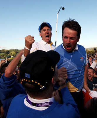 NEWPORT, WALES - OCTOBER 04:  Graeme McDowell (R) and Ian Poulter of Europe celebrates the victory for the European team at the end of the singles matches during the 2010 Ryder Cup at the Celtic Manor Resort on October 4, 2010 in Newport, Wales.  (Photo b