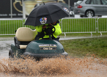 NEWPORT, WALES - OCTOBER 03:  Cart passes through the rain and mud during the weather delay prior to the restart of the Fourball & Foursome Matches during the 2010 Ryder Cup at the Celtic Manor Resort on October 3, 2010 in Newport, Wales.  (Photo by Richa