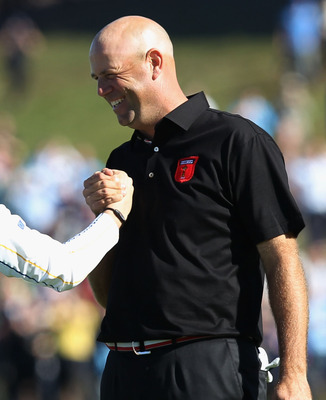NEWPORT, WALES - OCTOBER 04:  Rory McIlroy of Europe shakes hands with Stewart Cink (R) of the USA on the 18th green after they halved their match in the singles matches during the 2010 Ryder Cup at the Celtic Manor Resort on October 4, 2010 in Newport, W