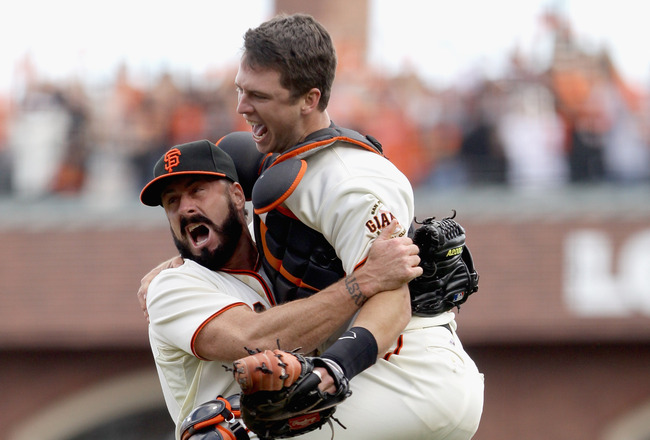 SAN FRANCISCO - OCTOBER 03:  Buster Posey #28 and Brian Wilson #38 of the San Francisco Giants celebrate after they beat the San Diego Padres to win the National League West Title at AT&T Park on October 3, 2010 in San Francisco, California.  (Photo by Ez