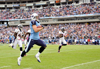 NASHVILLE, TN - OCTOBER 03:  Marc Mariani #83 of the Tennessee Titans runs a kickoff back for a touchdown aganst the Denver Broncos at LP Field on October 3, 2010 in Nashville, Tennessee. Denver won 26-20.  (Photo by Grant Halverson/Getty Images)