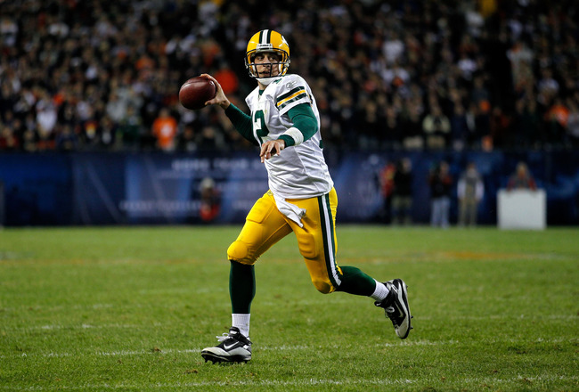 CHICAGO - SEPTEMBER 27:  Quarterback Aaron Rodgers #12 of the Green Bay Packers rolls out to pass against the Chicago Bears at Soldier Field on September 27, 2010 in Chicago, Illinois.  (Photo by Jonathan Daniel/Getty Images)