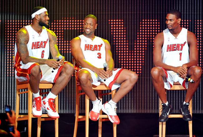MIAMI - JULY 09:   LeBron James #6, Dwyane Wade #3 and Chris Bosh #1 of the Miami Heat speak after being introduced to fans during a welcome party at American Airlines Arena on July 9, 2010 in Miami, Florida.  (Photo by Doug Benc/Getty Images)