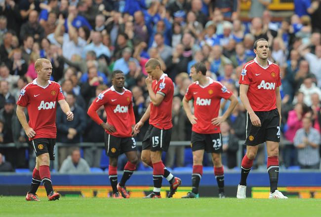 LIVERPOOL, ENGLAND - SEPTEMBER 11: John O'Shea and Paul Scholes of Manchester United look dejected after the first Everton goal during the Barclays Premier League match between Everton and Manchester United at Goodison Park on September 11, 2010 in Liverp