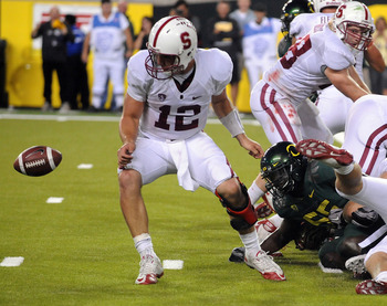EUGENE, OR - OCTOBER 2: Quarterback Andrew Luck of the Stanford Cardinal can't find the ball as he fumbles it near the goal line in the fourth quarter of the game against the the Oregon Ducks at Autzen Stadium on October 2, 2010 in Eugene, Oregon. Oregon