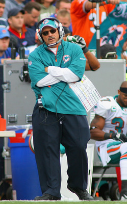 ORCHARD PARK, NY - SEPTEMBER 12: Tony Sparano, head coach of the Miami Dolphins stands on the sidelines during the NFL season opener against the Buffalo Bills at Ralph Wilson Stadium on September 12, 2010 in Orchard Park, New York.  (Photo by Rick Stewart