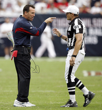 HOUSTON - SEPTEMBER 12:  Houston Texans head coach Gary Kubiak has words with referee Ed Hochuli after the Texans were charged with a timeout after the play clock was zero against the indianapolis Colts during the NFL season opener at Reliant Stadium on S