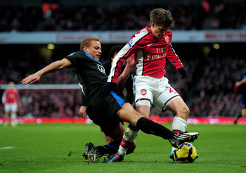 LONDON, ENGLAND - JANUARY 31:  Andrei Arshavin of Arsenal is tackled by Wes Brown of Manchester United during the Barclays Premier League match between Arsenal and Manchester United at The Emirates Stadium on January 31, 2010 in London, England.  (Photo b