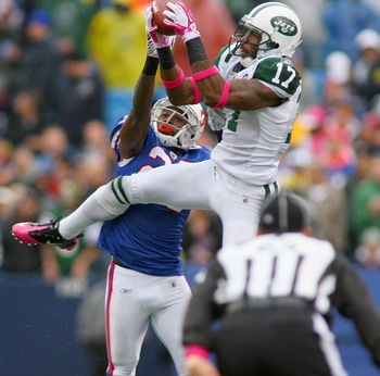 ORCHARD PARK, NY - OCTOBER 03: Braylon Edwards #17  of the New York Jets makes a catch over Drayton Florence #29 of  the Buffalo Bills at Ralph Wilson Stadium on October 3, 2010 in Orchard Park, New York. The Jets won 38-14. (Photo by Rick Stewart/Getty I