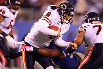 EAST RUTHERFORD, NJ - OCTOBER 03:  Jay Cutler #6 of the Chicago Bears gets sacked by Justin Tuck #91 of the New York Giants at New Meadowlands Stadium on October 3, 2010 in East Rutherford, New Jersey.  (Photo by Andrew Burton/Getty Images)